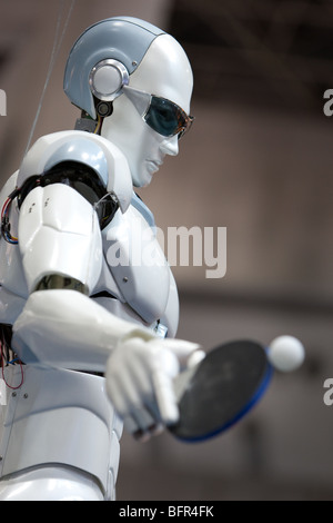 'TOPIO' a ping pong playing robot, produced by Vietnamese company Tosy, on display at the International Robot Exhibition, - Stock Photo