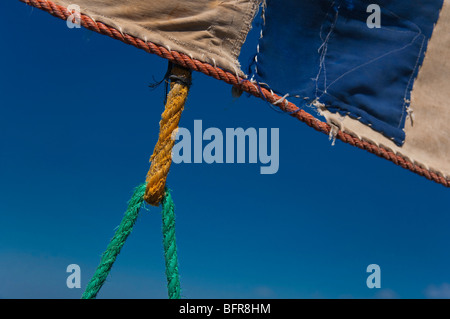 Colourful rope attached to sail - Stock Photo
