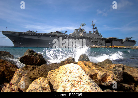 The amphibious assault ship USS Kearsarge visiting the Netherlands Antilles for the humanitarian service project. - Stock Photo