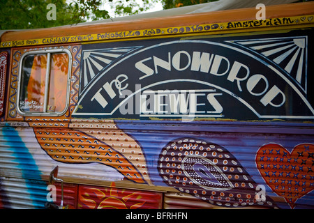 Colourful painted hippy camper van with The Snowdrop, Lewes lettering on the side. UK - Stock Photo
