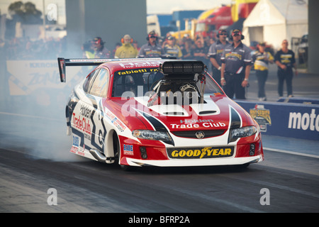 Australian Top Doorslammer driver, Maurice Fabietti, performing a burnout in his supercharged Holden Monaro. - Stock Photo