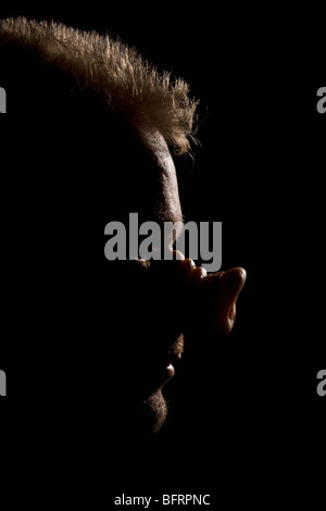 40 year old man with with the Swine Flu, on black background. - Stock Photo
