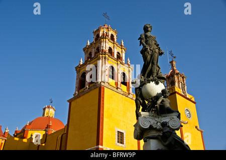 Basilica of Our Lady of Guanajuato with statue on fountain in Plaza del la Pax - Stock Photo