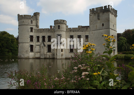 Bouchout Castle and moat with foreground flowers at the National Botanic Garden of Belgium at Meise (near Brussels) - Stock Photo