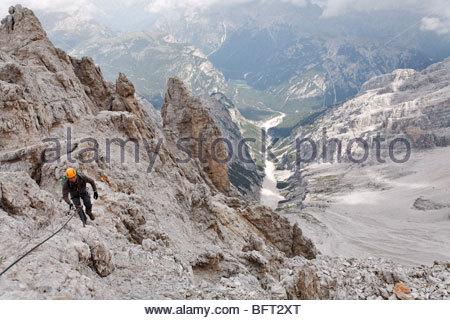 Man on Via Ferrata, Mt Cristallo, Dolomites, Italy - Stock Photo