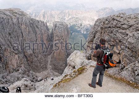 Man Looking at View, Brigata Tridentina Via Ferrata, Sella Massif, Dolomites, Italy - Stock Photo
