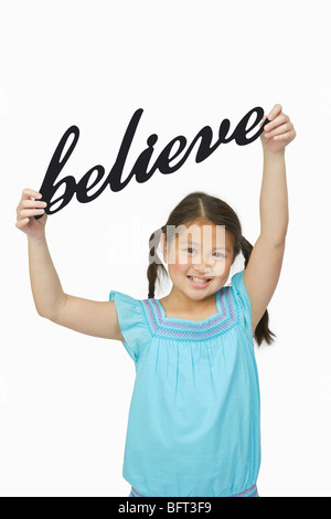 Girl Holding Believe Sign