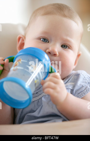 Baby Girl With Sippy Cup - Stock Photo