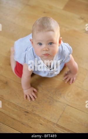 Baby Girl Crawling on the Floor - Stock Photo