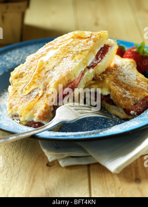 French Toast with Strawberries and Cream, Powdered Sugar and Syrup - Stock Photo