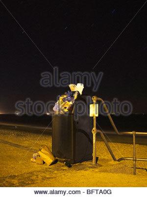 Public bin at night - Stock Photo