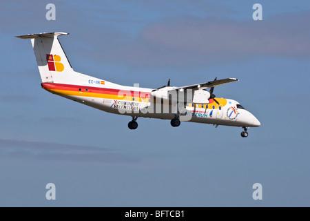 A De Havilland Canada/ Bombadier Dash 8 turbo prop feeder liner of the Spanish airline Air Nostrum/ Iberia - Stock Photo