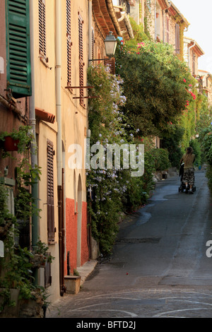 Colorful and narrow street in the old town of Antibes - Stock Photo
