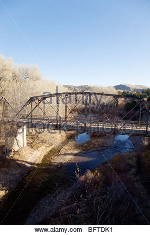 Old abandoned steel truss highway bridge US 180 over San Francisco River 'New Mexico' - Stock Photo