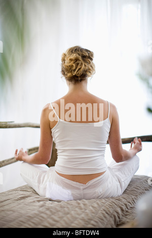 middle-aged woman doing yoga - Stock Photo