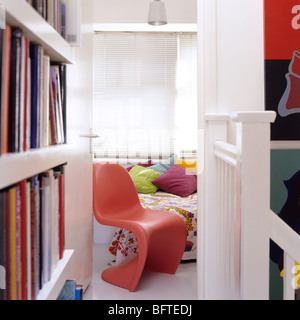 Hall landing with bookshelf looking through to bedroom in a modern flat - Stock Photo