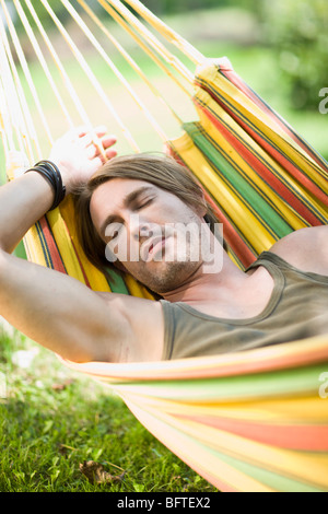 Man sleeping in a hammock - Stock Photo