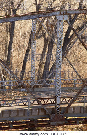 Detail of riveted beams Old abandoned steel truss highway bridge US 180 over San Francisco River 'New Mexico' - Stock Photo