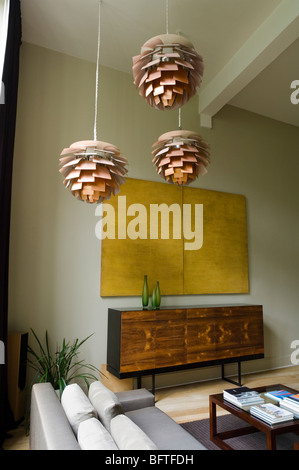 Living room with sofa and Louis Poulsen Artichoke lights - Stock Photo