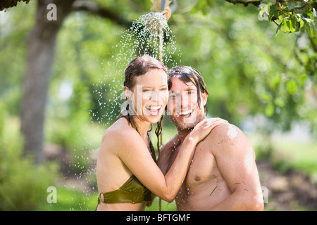 man and woman in nature - Stock Photo