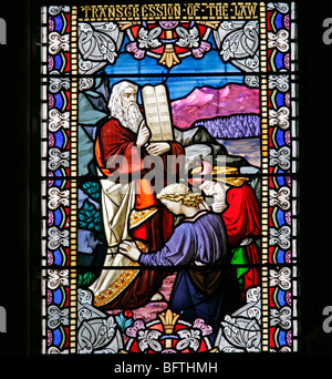 Detail of a stained glass window depicting Moses with the Ten Commandment tablets, Wilton Parish Church, Wilton, - Stock Photo