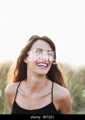 woman on the beach enjoying sunset - Stock Photo