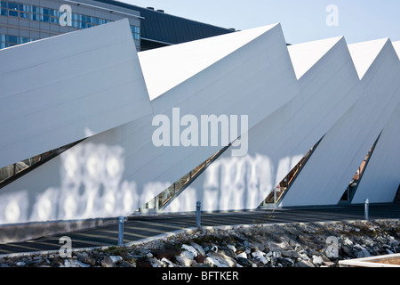 Polaria museum building that represents ice floes that have been pressed up on land by the rough seas of the Arctic - Stock Photo