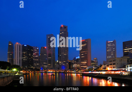 Skyline of Skyscrapers on Boat Quay, or the Financial District along Singapore River, Lit At Night, Singapore - Stock Photo