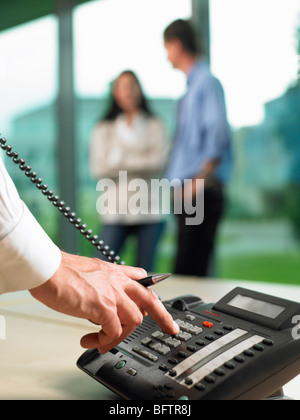Man dialing a number - Stock Photo