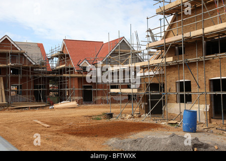 New houses under constuction on a building site - Stock Photo