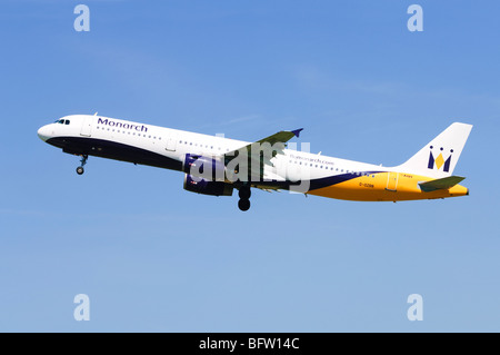 Airbus A321 operated by Monarch Airlines climbing out from take off at Birmingham Airport, UK. - Stock Photo