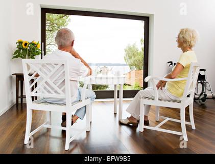 senior couple having tea - Stock Photo