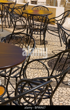 Empty tables and chairs at an outside Cafe Funchal Madeira Portugal EU Europe - Stock Photo