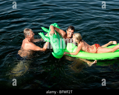Family playing in water - Stock Photo