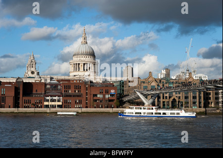 Tour boat on the river Thames passing St Paul's Cathedral, London, England, UK - Stock Photo