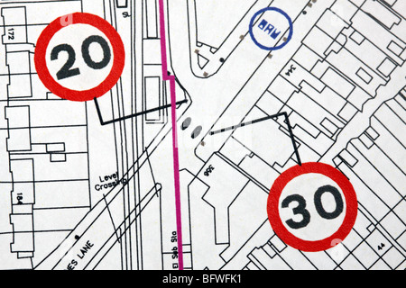 Urban planning road traffic calming 20 mph speed limit sign zones plans in GB UK town city - Stock Photo