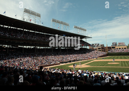 Baseball at Wrigley Field, Chicago, Illinois, USA. The Chicago Cubs pitching against the Saint Louis Cardinals - Stock Photo