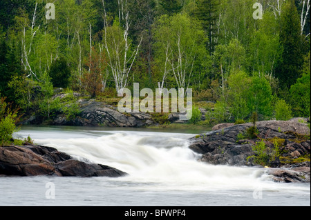 Waterfall and rapids on the Wanapitei River in spring, Greater Sudbury, Ontario, Canada - Stock Photo
