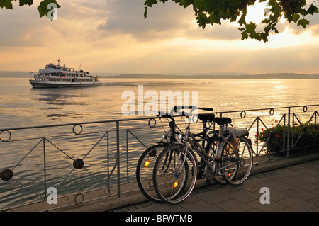 Bicycles and ship at Lake Constance, Meersburg, Baden-Wuerttemberg, Germany - Stock Photo