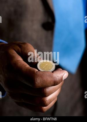 Business man ready to flip euro coin - Stock Photo
