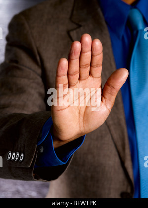Business man with palm to camera - Stock Photo