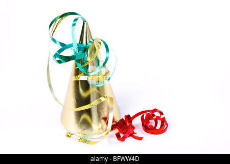 Gold Party Hat with red ribbon isolated against white background. - Stock Photo