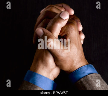 Business man with hands clasped together - Stock Photo