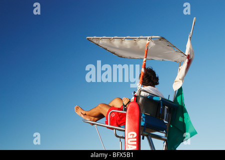Lifeguard on beach in Spain - Stock Photo