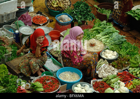 Smiling Malay or Malaysian Women Selling Fruit & Vegetables at the Central Market, Kota Bahru, Malaysia - Stock Photo