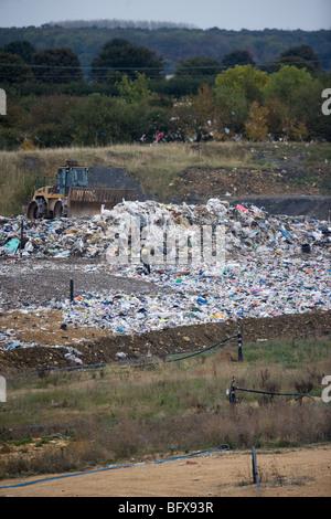 Plastic into a landfill site - Stock Photo