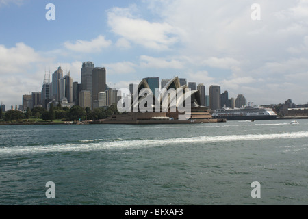 view of the sydney skyline and the sydney opera house from a ferry coming back from taronga zoo new south wales - Stock Photo