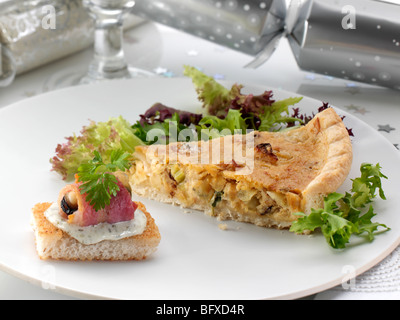 Individual Stilton quiche slice and an angel on horse back