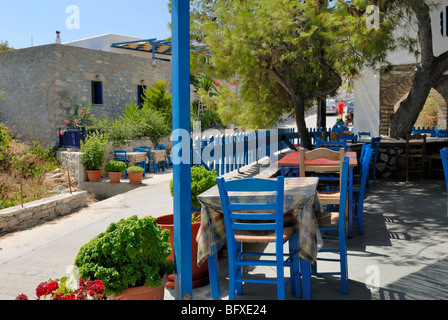 There are only few taverns in Agios Georgios. Perigiali tavern serves fresh fish dishes and other Greek cuisine. - Stock Photo