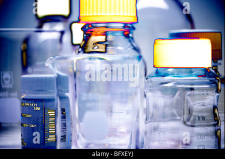 assortment of lab bottles and beakers - Stock Photo